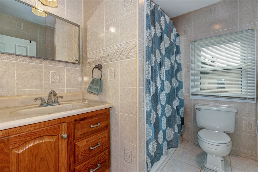Real Estate Photography - 409 Rosewood Dr, Newark, DE, 19713 - Updated bath, ceramic tile floor