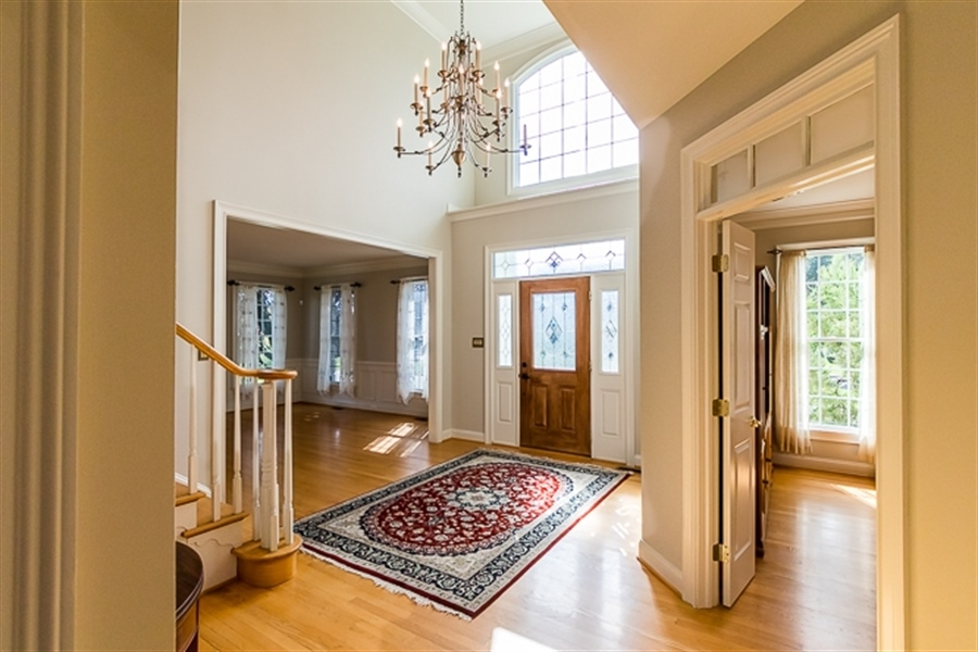 Real Estate Photography - 7 Derbyshire Way, Wilmington, DE, 19807 - Two story foyer with study & designer lighting