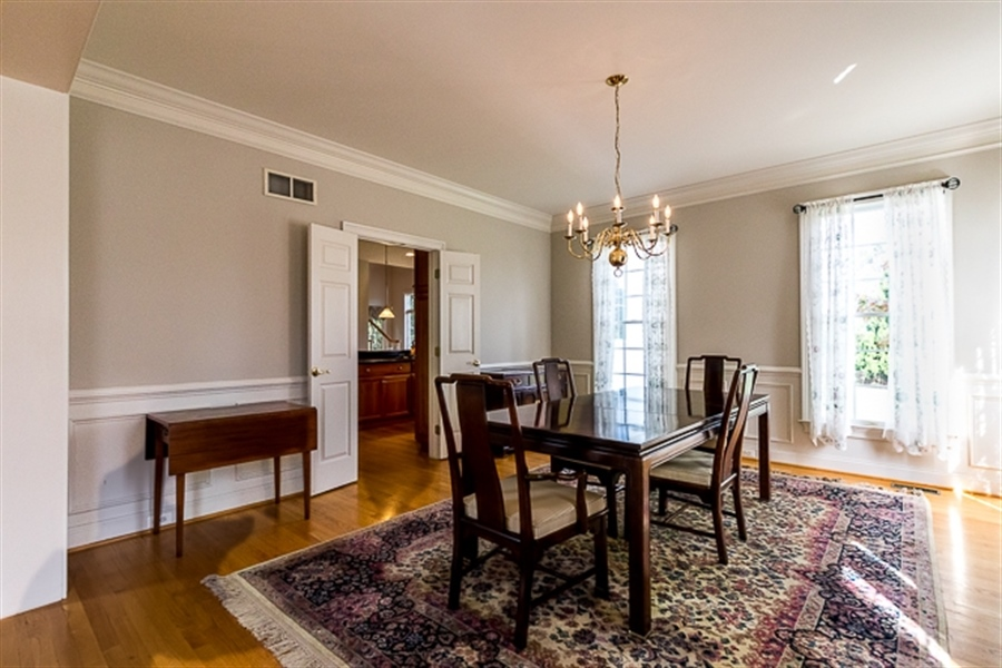 Real Estate Photography - 7 Derbyshire Way, Wilmington, DE, 19807 - Dining room opens to living room for maximum flow
