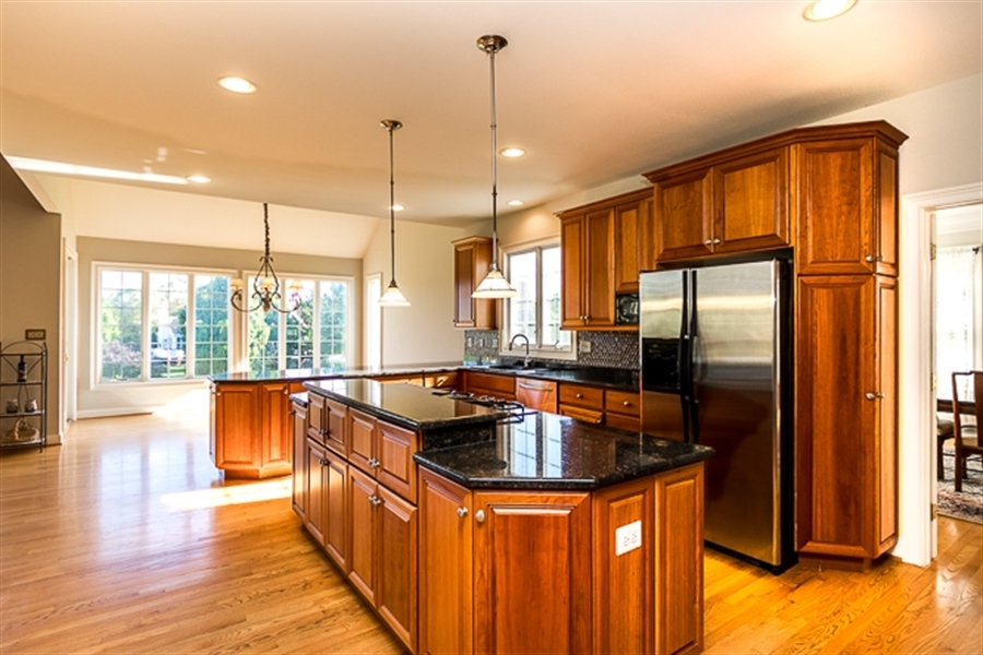 Real Estate Photography - 7 Derbyshire Way, Wilmington, DE, 19807 - large open kitchen with pendant lighting