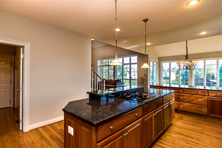 Real Estate Photography - 7 Derbyshire Way, Wilmington, DE, 19807 - view of island, laundry and breakfast room