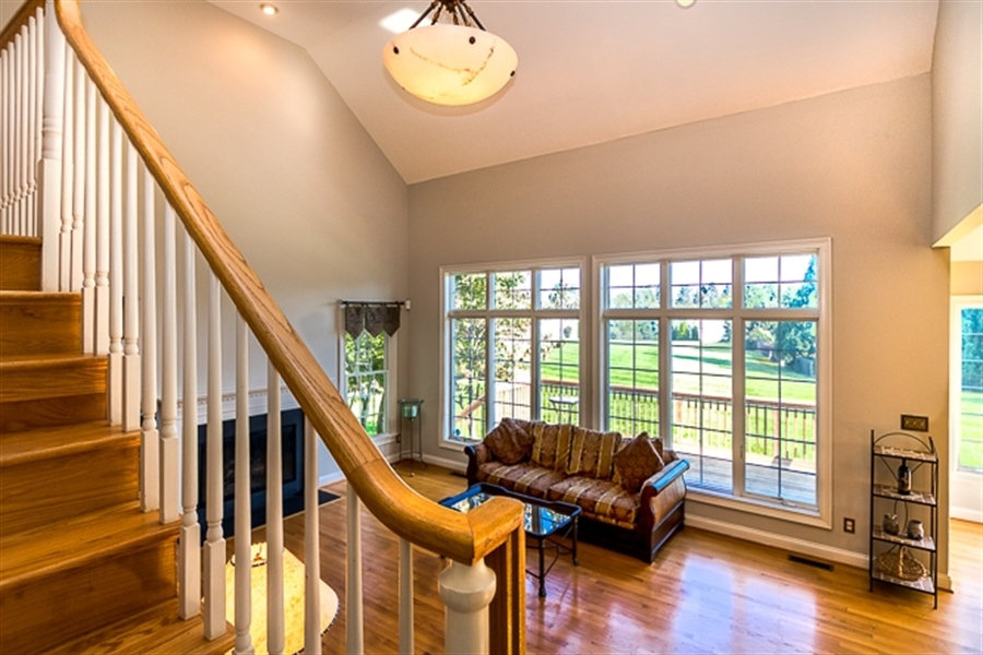 Real Estate Photography - 7 Derbyshire Way, Wilmington, DE, 19807 - rear staircase to 2 story family room