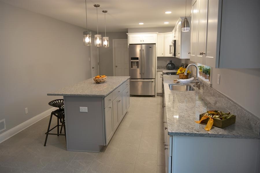 Real Estate Photography - 807 Dallam Rd, Newark, DE, 19711 - Kitchen with Granite Countertops & SS Appliances