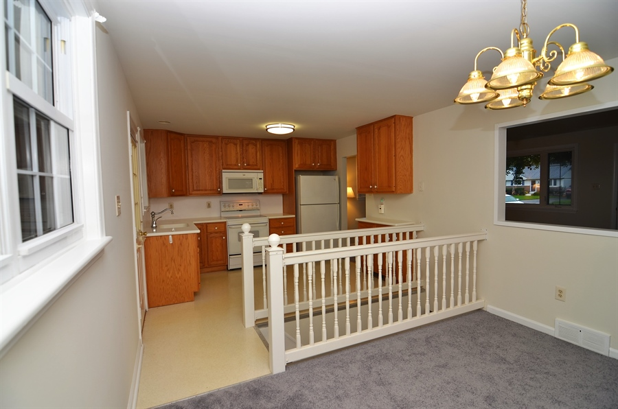 Real Estate Photography - 2384 2Nd Avenue, Boothwyn, DE, 19061 - Kitchen Open to Dining Room