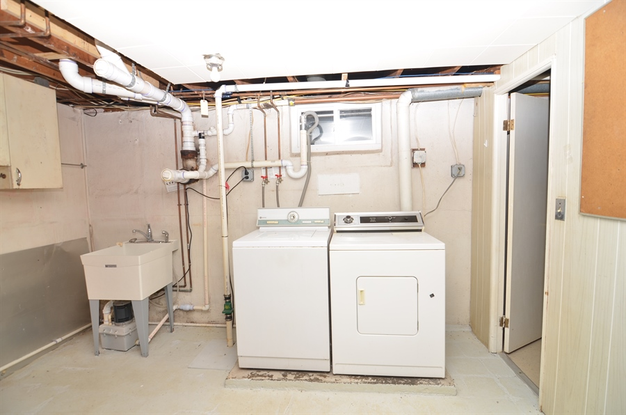 Real Estate Photography - 2384 2Nd Avenue, Boothwyn, DE, 19061 - Large Laundry Room