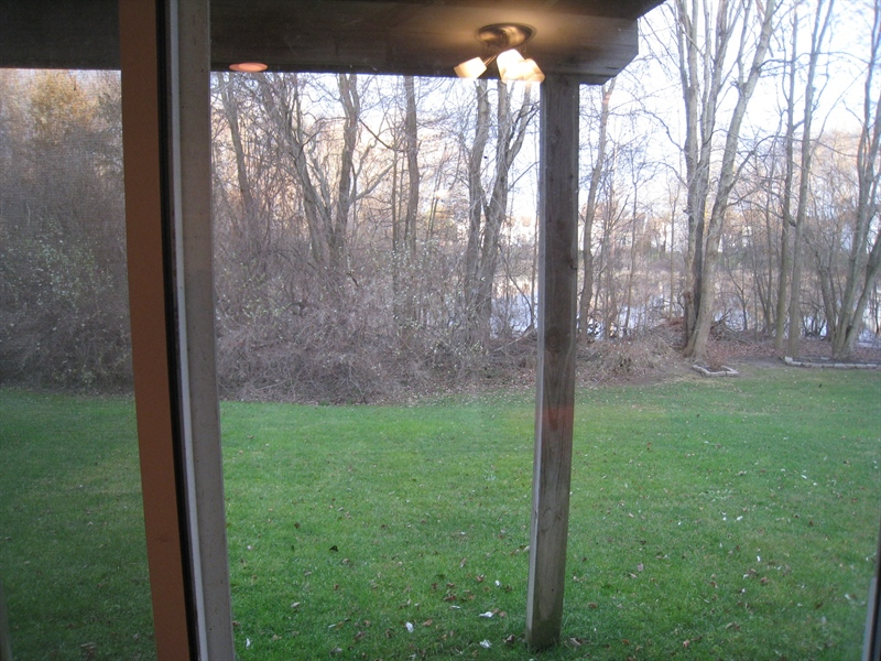 Real Estate Photography - 47 Wicklow Rd, Bear, DE, 19701 - View from fam. room toward rear wooded area