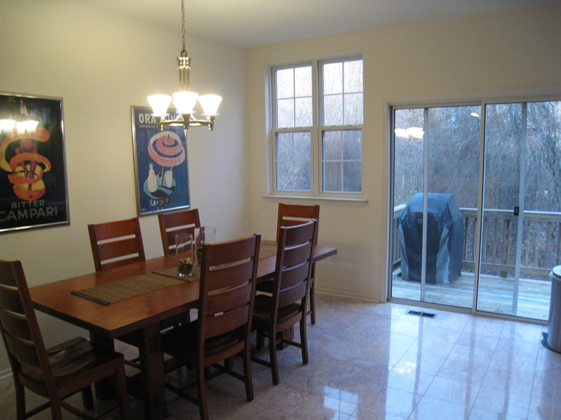 Real Estate Photography - 47 Wicklow Rd, Bear, DE, 19701 - Dining area, off kitchen, with access to rear deck