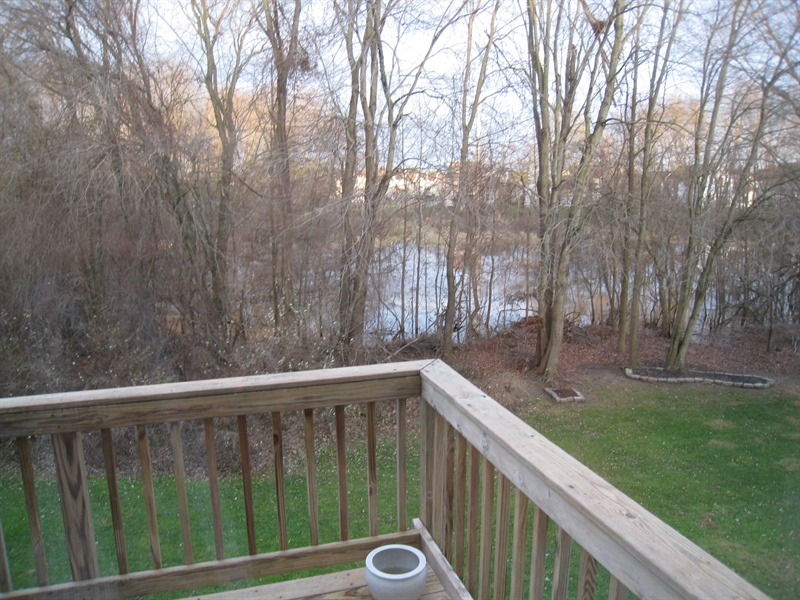 Real Estate Photography - 47 Wicklow Rd, Bear, DE, 19701 - Deck off kitchen w/view of wooded area & pond