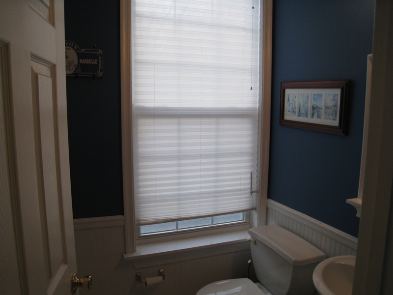 Real Estate Photography - 47 Wicklow Rd, Bear, DE, 19701 - Powder room just off living room