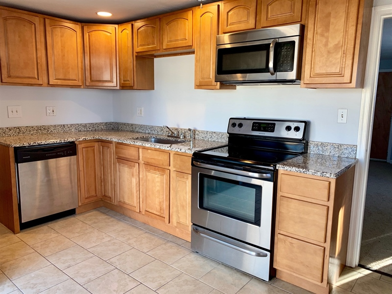 Real Estate Photography - 309 Howell Dr, New Castle, DE, 19720 - Updated Kitchen with Granite & SS Appliances