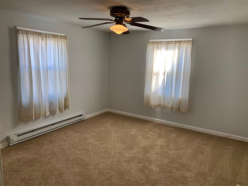 Real Estate Photography - 309 Howell Dr, New Castle, DE, 19720 - Master Bedroom w New Carpet and nice closet