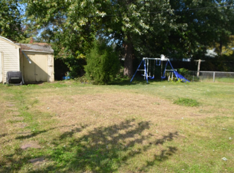 Real Estate Photography - 309 Howell Dr, New Castle, DE, 19720 - Nice size fenced yard
