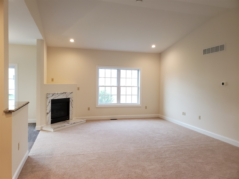 Real Estate Photography - 107 Delhi Ct, Smyrna, DE, 19977 - Great Room with Cathedral Ceiling