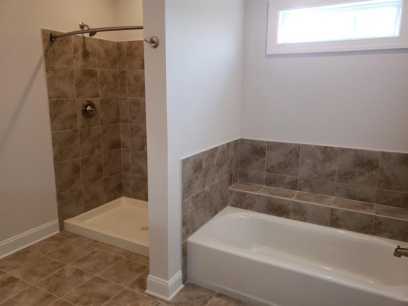 Real Estate Photography - 129 Delhi Ct, Smyrna, DE, 19977 - Master Bathroom