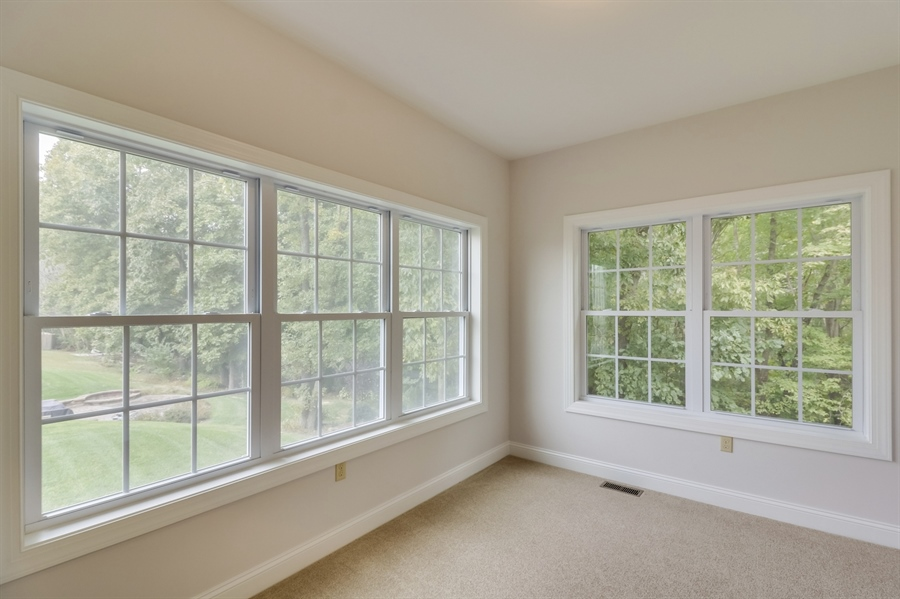 Real Estate Photography - 459 India Dr, Smyrna, DE, 19977 - Inviting Sunroom wih a Picture-like View