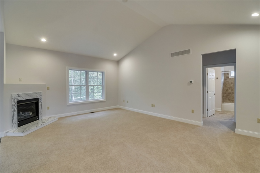 Real Estate Photography - 459 India Dr, Smyrna, DE, 19977 - Great Room w/ Cathedral Ceiling & Corner Fireplace