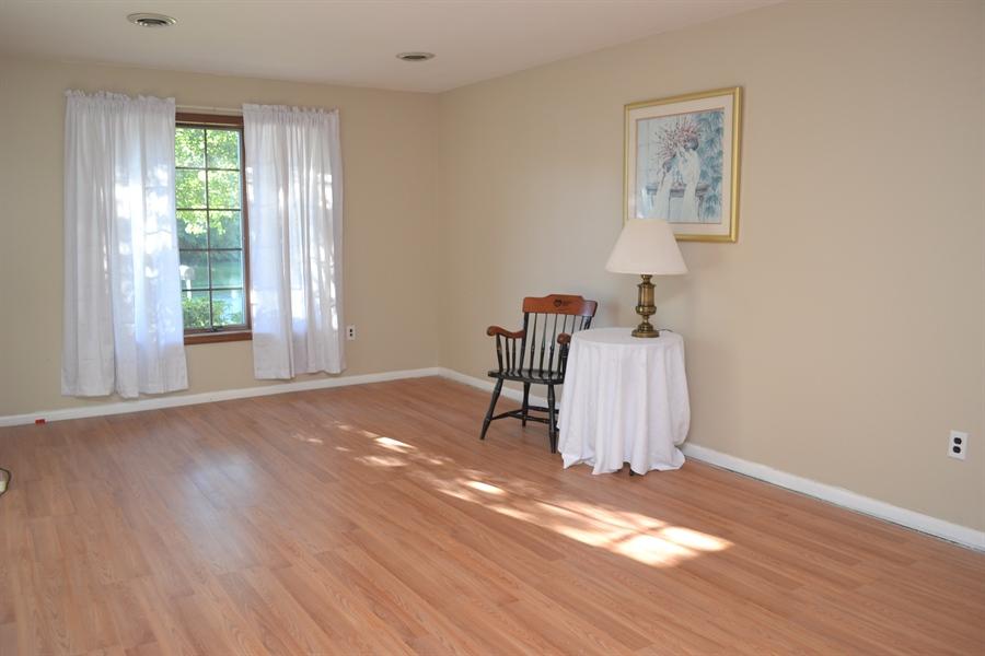 Real Estate Photography - 23 Dunbar Rd, Newark, DE, 19711 - Living Room w/ New Flooring
