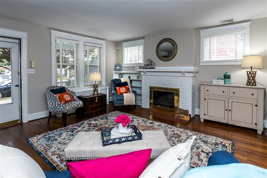 Real Estate Photography - 2417 W 18th St, Wilmington, DE, 19806 - Woodburning fireplace w/ painted brick/tile hearth