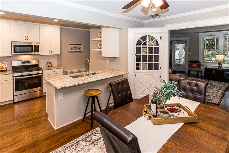 Real Estate Photography - 2417 W 18th St, Wilmington, DE, 19806 - Kitchen peninsula with overhang for bar stools