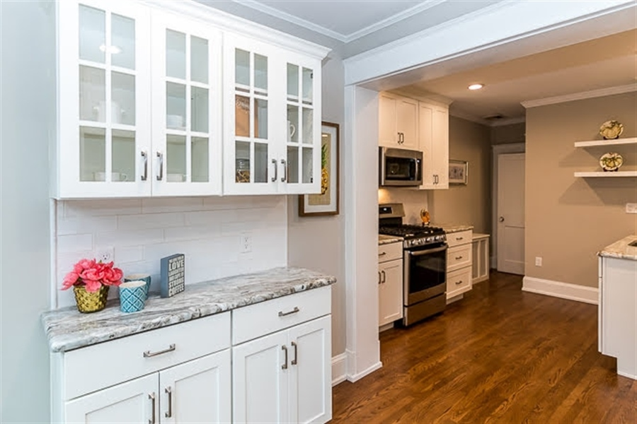 Real Estate Photography - 2417 W 18th St, Wilmington, DE, 19806 - Coffee bar includes glass cabinets/tile backsplash