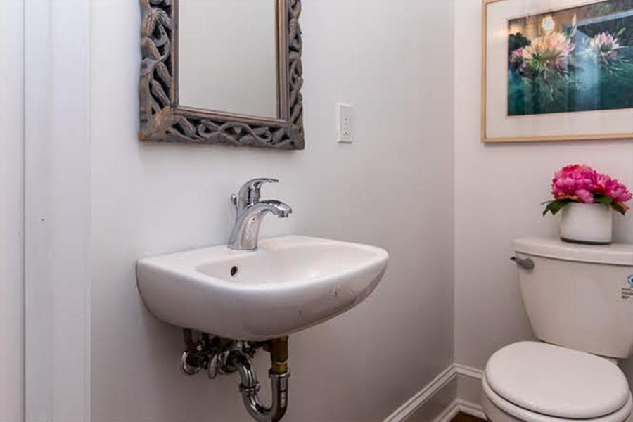 Real Estate Photography - 2417 W 18th St, Wilmington, DE, 19806 - Brand new half bath/powder room w/hardwood floors