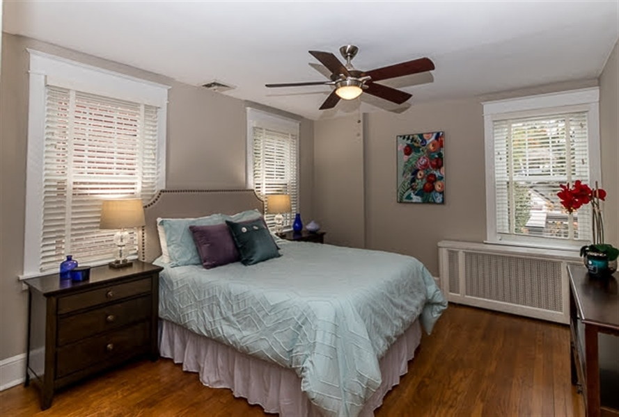 Real Estate Photography - 2417 W 18th St, Wilmington, DE, 19806 - Bright & cheery master bedroom with three windows!