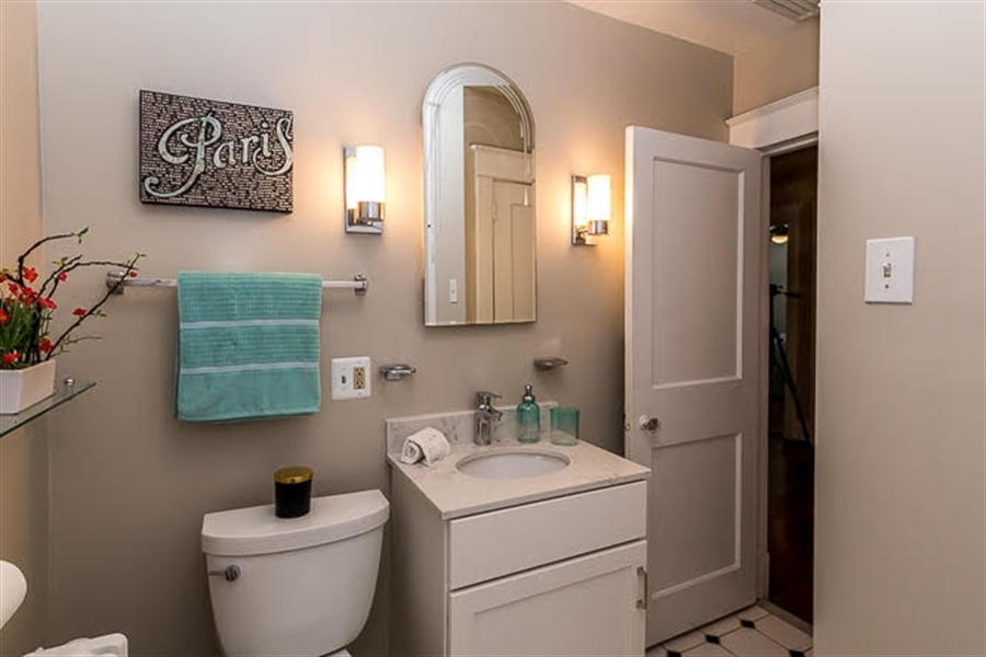Real Estate Photography - 2417 W 18th St, Wilmington, DE, 19806 - Second floor full bath with tiled floor/new vanity