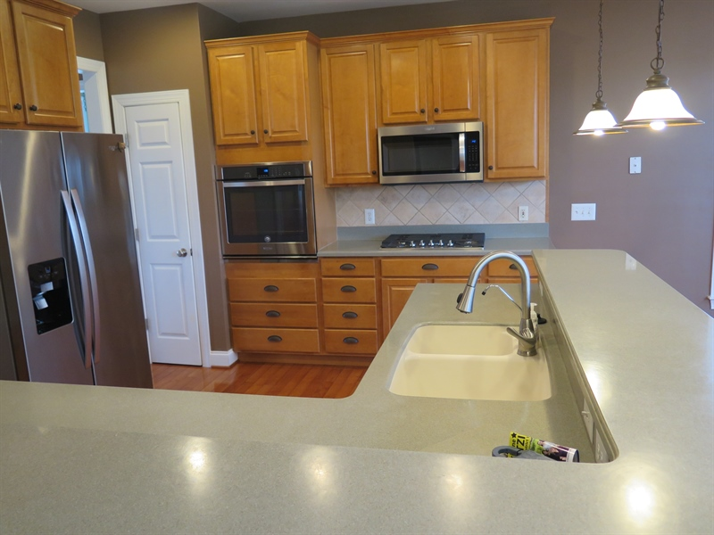 Real Estate Photography - 134 Cazier Dr, Middletown, DE, 19709 - Custom Kitchen W/Penninsula Island