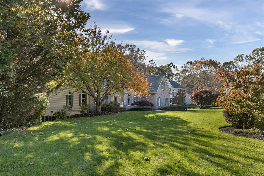 Real Estate Photography - 833 Westridge Dr, Hockessin, DE, 19707 - Beautiful Level Front Yard With Wooded Open Space