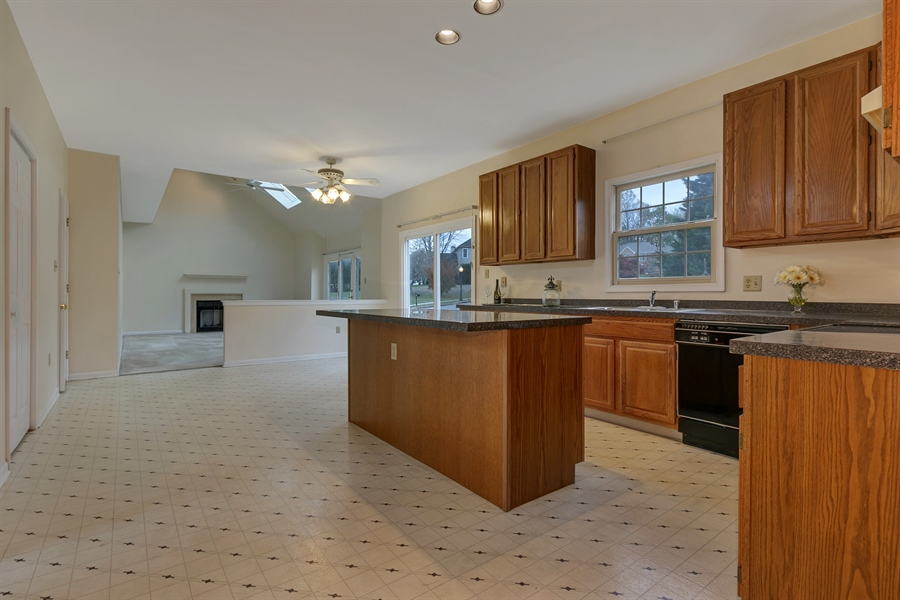 Real Estate Photography - 125 Brook Run, Hockessin, DE, 19707 - KITCHEN OPENS TO FAMILY ROOM