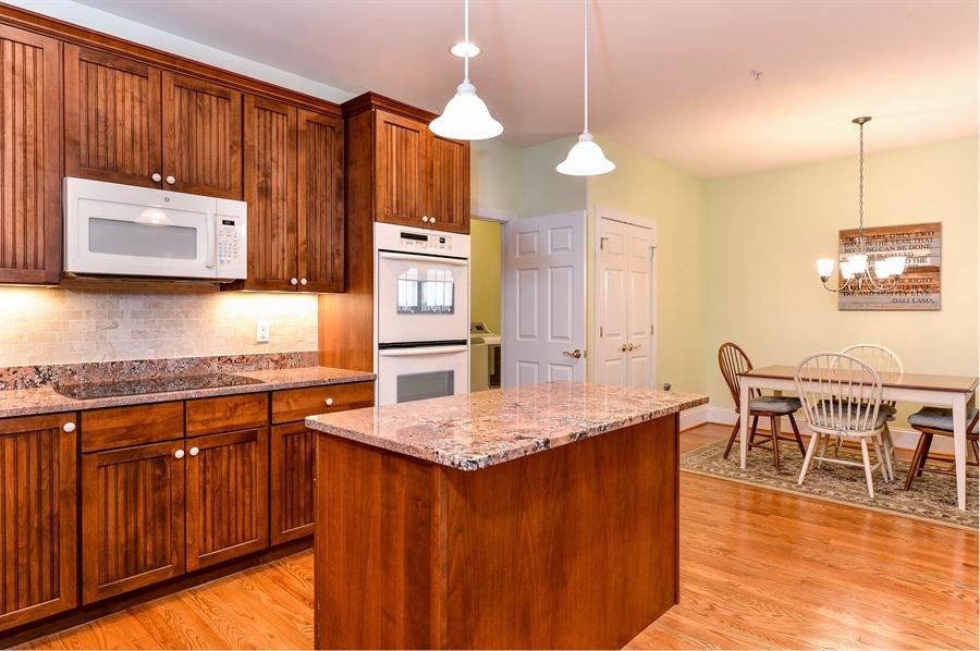 Real Estate Photography - 12 Briarcreek Ct, Newark, DE, 19711 - Kitchen-Breakfast area, granite, tile backsplash