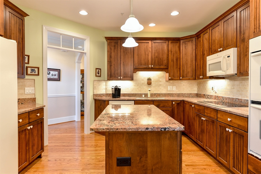 Real Estate Photography - 12 Briarcreek Ct, Newark, DE, 19711 - Lots of lighting including under cabinets