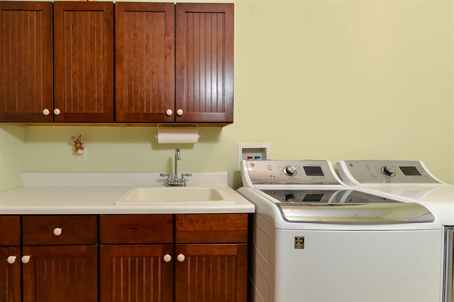 Real Estate Photography - 12 Briarcreek Ct, Newark, DE, 19711 - Laundry/Mud room to garage-cabinets w/utility sink