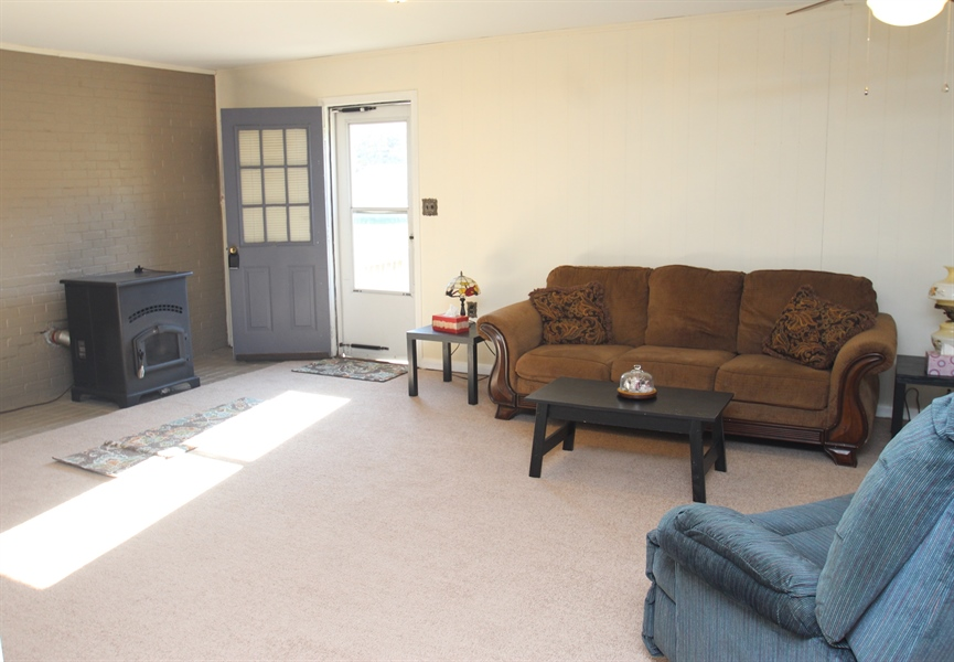 Real Estate Photography - 2512 Oldfield Point Rd, Elkton, MD, 21921 - Living Room w/Pellet Stove