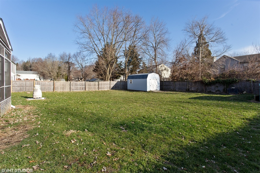 Real Estate Photography - 237 Cheyenne Dr, Bear, DE, 19701 - Fenced in rear yard with large shed
