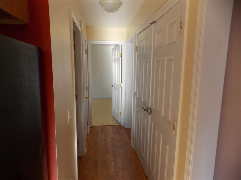 Real Estate Photography - 54 Preserve Dr, Clayton, DE, 19938 - Hallway main floor to bedrooms