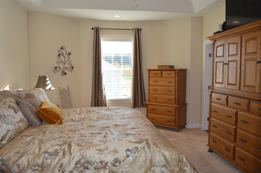 Real Estate Photography - 24593 Hollytree Cir, Georgetown, DE, 19947 - Master bedroom with tray ceiling & bay window