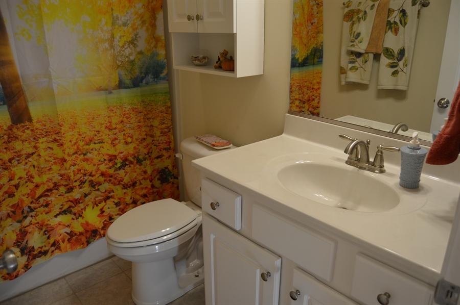 Real Estate Photography - 24593 Hollytree Cir, Georgetown, DE, 19947 - Full bathroom on main floor