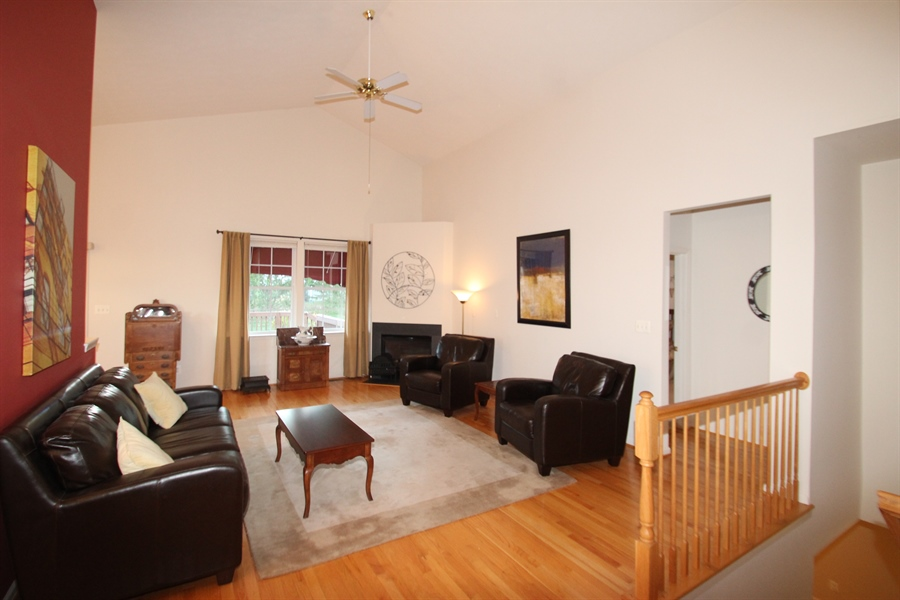 Real Estate Photography - 235 Thomas Jefferson Ter, Elkton, MD, 21921 - Living Room with vaulted ceiling and fireplace