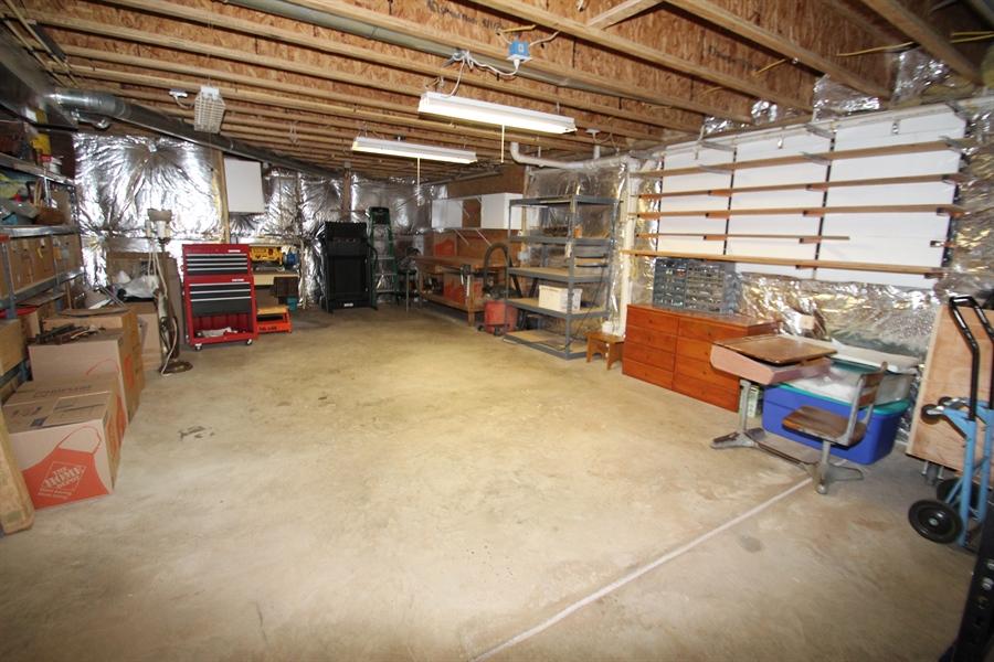 Real Estate Photography - 235 Thomas Jefferson Ter, Elkton, MD, 21921 - Unfinished basement/workshop