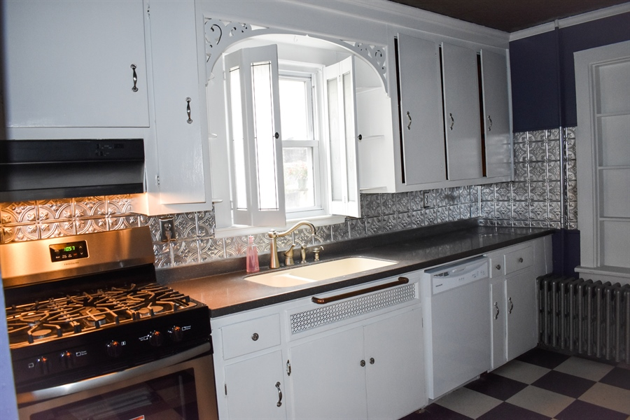 Real Estate Photography - 513 W Main Street, Clayton, DE, 19938 - Stainless Steel Gas Stove
