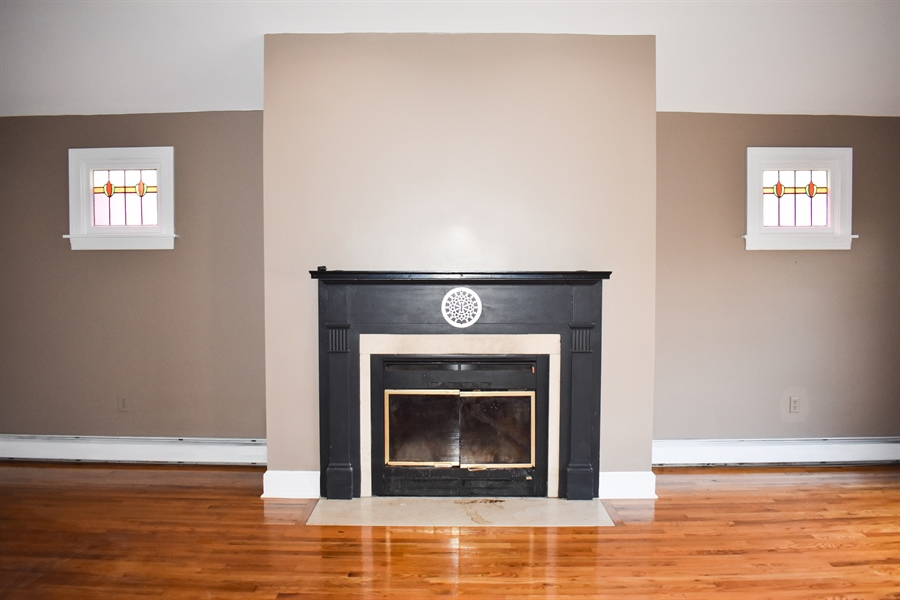 Real Estate Photography - 513 W Main Street, Clayton, DE, 19938 - Fireplace in Family Rm