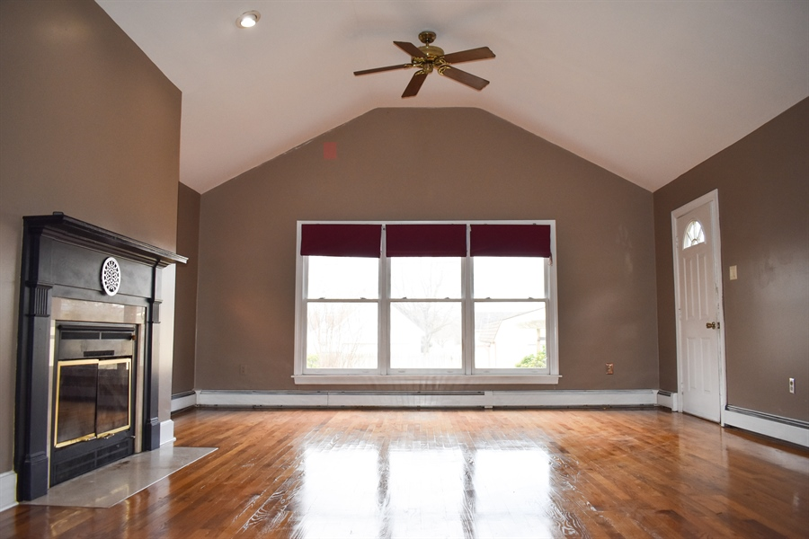 Real Estate Photography - 513 W Main Street, Clayton, DE, 19938 - Vaulted Ceiling in Family Rm