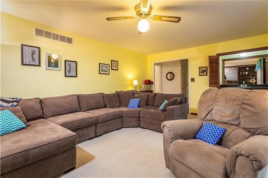 Real Estate Photography - 5 Signal Hill Dr, Hockessin, DE, 19707 - Family Room has fireplace and wet bar