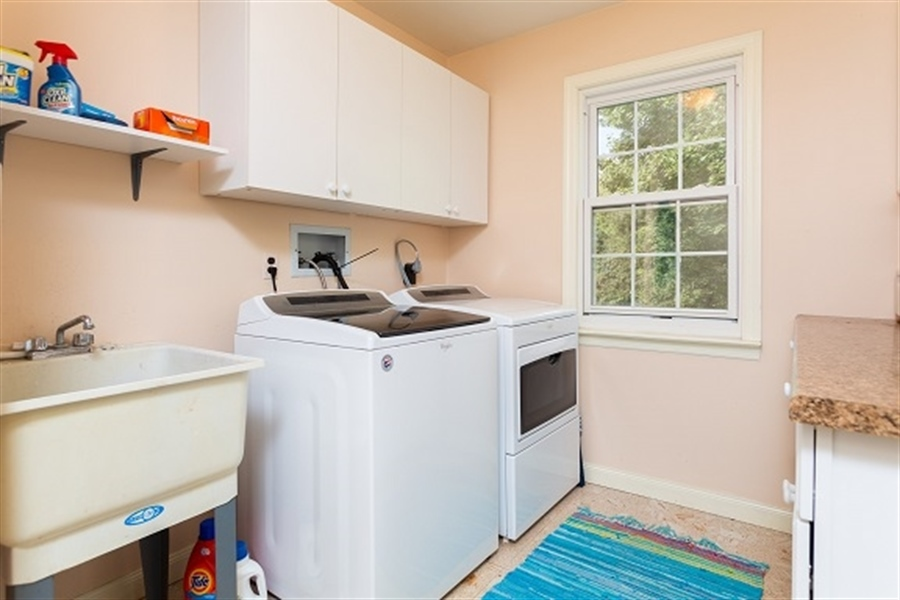 Real Estate Photography - 5 Signal Hill Dr, Hockessin, DE, 19707 - Two walls of storage in Laundry Room