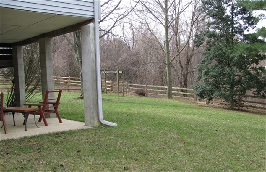 Real Estate Photography - 5 Signal Hill Dr, Hockessin, DE, 19707 - View of lower patio and wooded open space