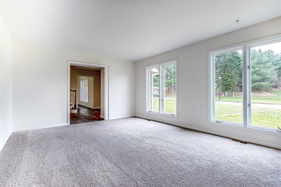Real Estate Photography - 227 Hawkes Ct, Hockessin, DE, 19707 - Living Room with Large Windows