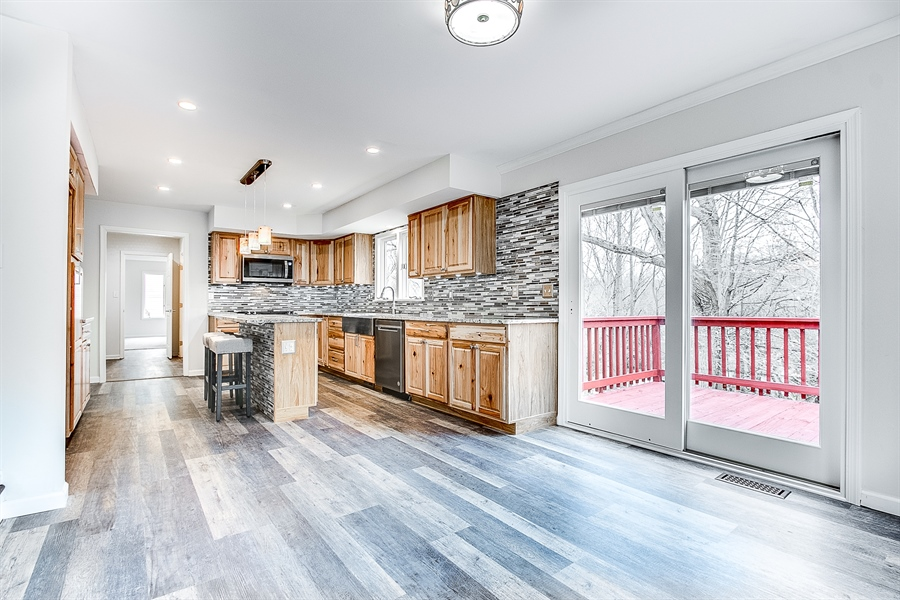 Real Estate Photography - 227 Hawkes Ct, Hockessin, DE, 19707 - Kitchen with Sliders to Rear Deck