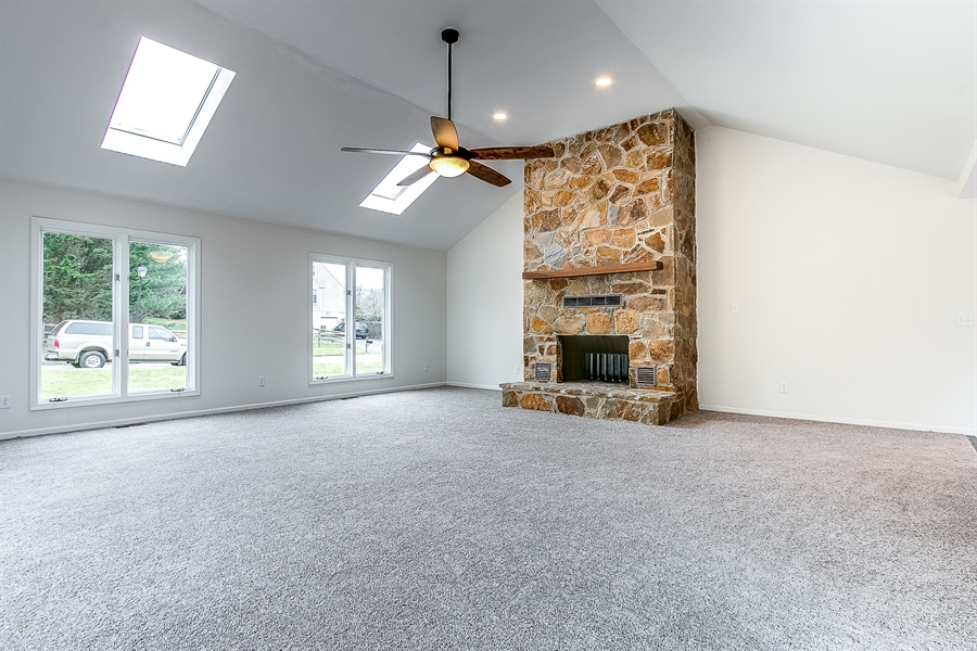 Real Estate Photography - 227 Hawkes Ct, Hockessin, DE, 19707 - Family Room with Vaulted Ceiling and Skylights