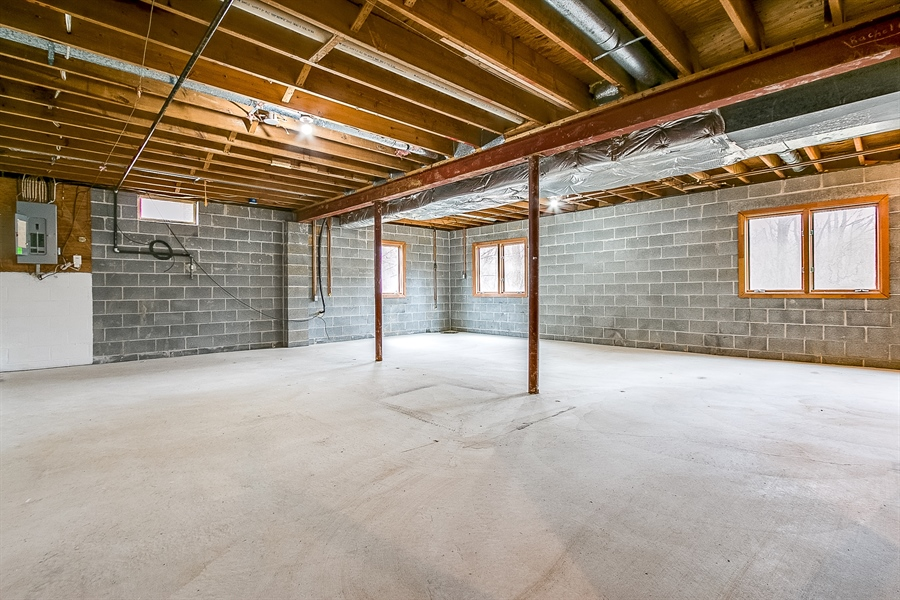 Real Estate Photography - 227 Hawkes Ct, Hockessin, DE, 19707 - Large Unfinished Walk Out Basement